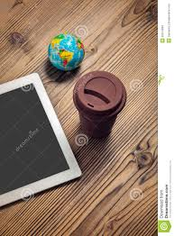 Computer Coffee Table Tablet Computer Coffee Cup And Globe On Wood Table Stock Photo