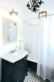 powder room lighting above mirror incredible double sconce bathroom barn light electric photo gallery bath remarkable powder room lighting