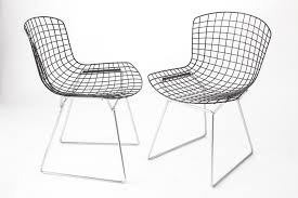 vintage wire chairs with black seats chromed bases by harry
