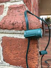 How To Fasten Christmas Lights To House How To Hang Christmas Lights On Brick Hanging Christmas