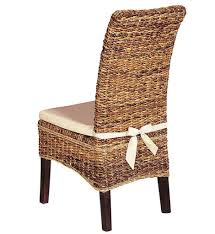 armless wicker chair with simple white cushions