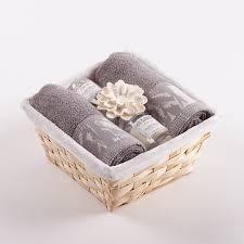 this gift basket of towels and candles with a diffuser will delight every fan of practical and very elegant gifts