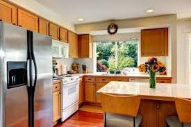 kitchen design white cabinets white appliances. Cozy Kitchen With Honey Color Cabinets, White Appliances And Island  Fresh Flowers Stock Design Cabinets N