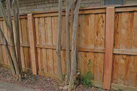build a wooden facade around metal posts to achieve an all wood look