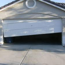 garage door off trackGarage Door Repair Services