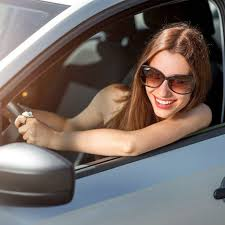 Woman driving and breast feeding