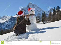 Girl decorating a snowman