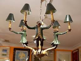 chandelier with painted monkeys