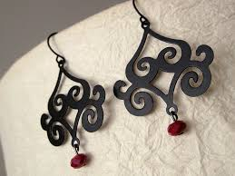 these darling chandelier earrings from urbanite jewelry are simply stunning striking matte black is set off by gorgeous red crystals making these a