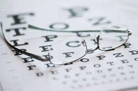 Lying Eye Chart Eyeglasses Lying On Eye Chart Stock Photo