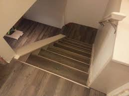 drop done luxury vinyl plank in eastern township with metal insert stair nosing