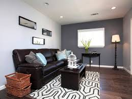 unique geometric rug with wooden floor for small living room interior design with grey accent wall color
