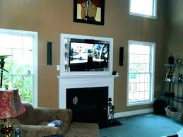 hanging tv over fireplace mounting above fireplace