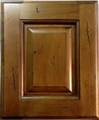 the rustic pecan cabinets do not have a glaze like the first 2 kitchen pictures glaze was added by the installer order a sample door to see the exact