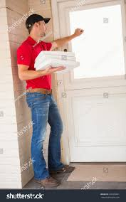 Delivery Man Holding Pizza While Knocking Stock Photo 236455861 ...