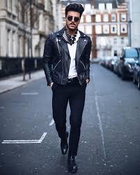 white polo shirt leather biker jacket dotted print cravat black dress pants