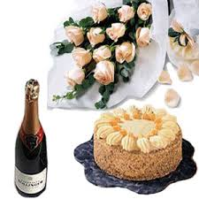 Send 12 Pink Roses Bouquet 12 Kg Pineapple Cake And Champagne To India