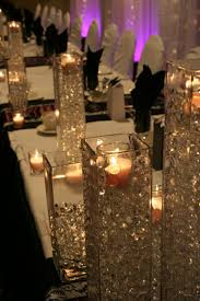 tall vases with sparkle and a candle in them. could be nice on sweets  tables, or in cocktail hour, or on the ledges in the windows. tons of  possibilities