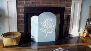 a painted fireplace screen