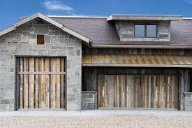 love love love how these custom wood doors pliment this very rustic home design rustic wooden garage doors