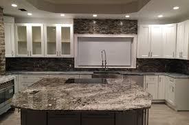 Kitchen Granites White Tiger Granite Caps The Oversized Kitchen Island Emrichprocom