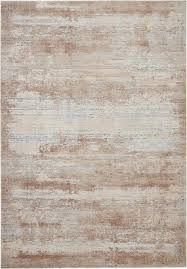 at home in a country cabin or urban loft the rustic textures collection from nourison blends earthen tones and contemporary abstracts together in