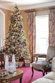 Christmas Tree Decorating Ideas for 2013 : / Very rich and tall Christmas  tree wrapped in oversized ornaments. Deer antlers in the tree?-