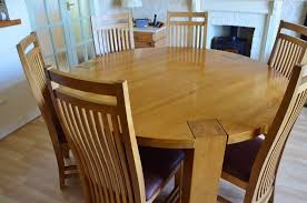solid oak large round dining table and 6 chairs