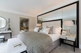 Double Mirrors. Mirrored headboard wall