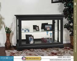 680594 howard miller black side door curio console
