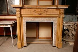 a 19th century french carved pibe fireplace mantel piece in neoclassical style the inverted