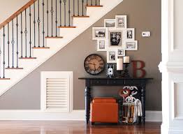 turn that blank wall under the stairs into a photo gallery wall
