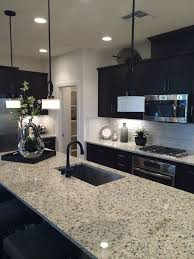 image of kitchen tile flooring dark cabinets granite countertops light tile floors dark kitchen cabinets