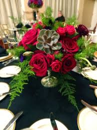 for the reception space we created tall silver candelabras with large fl arrangementixed them with low mercury glass compote bowl arrangements