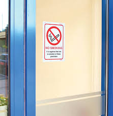 53020 no smoking against the law to smoke in premises a5 face sav 148x210mm safety sign