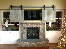 tv above fireplace hide over fireplace idea tv stand with fireplace
