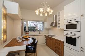 lighting for a small kitchen. Even In A Small Kitchen Like This, Nice Chandelier Can Heighten The Appeal Of Lighting For N