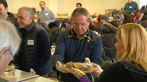 politicians and volunteers serve up hot meals at eva s village in paterson