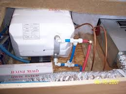 atwood hot water heater questions sunline coach owner s club the blue hose that runs vertical between the bottom white valve and the top tee that has a red hose leaving the hw heater is what we call a hot water