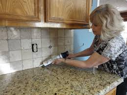 backsplash has been grouted sanded caulk is injected with cauling