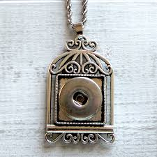 snap jewelry necklace in the shape of a birdcage holds one freckle snap by frilly freckles