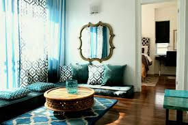 blue floor cushions with seats and low oriental rug brown sofa fl arrangement round table also