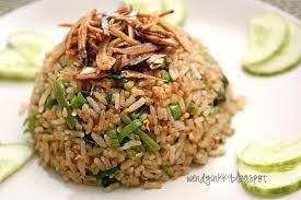 Heat oil in a large skillet or wok over high heat. Table For 2 Or More Nasi Goreng Kampung Malay Countryside Fried Rice