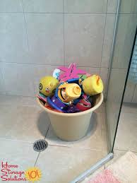use a flower pot with holes in the bottom to bath toys