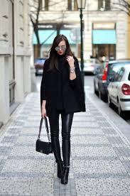 barbora ondrackova is wearing a black cape coat black knit turtleneck sweater leather leggings