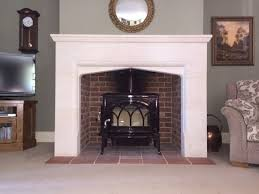 jotul f500 in majolica brown enamel in stone fireplace wood burning stoveswood