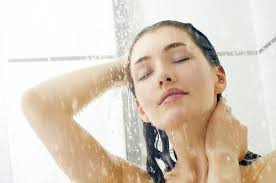 woman standing at the shower