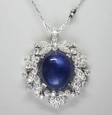 1940s raymond yard 15 83 carat star sapphire diamond and platinum pendant