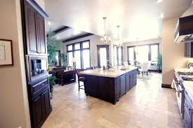 travertine kitchen floor large open with dark brown cabinets and double chandeliers over rectangular island tiles tile images dar