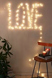 Use strands of lights to spell out a holiday greeting.